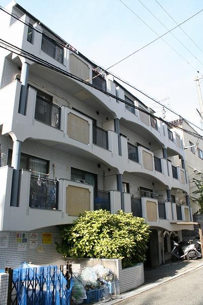 大阪府豊中市、南千里駅徒歩13分の築29年 4階建の賃貸マンション